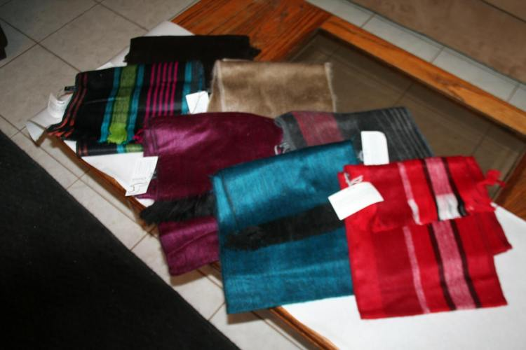 """Chris says:  """"These are some of the alpaca scarves. I also have brown and tan roving and yarn available and a couple felts too."""""""